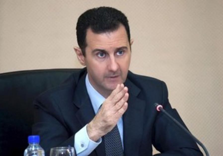 Syrian President Bashar Assad heading a cabinet meeting in Damascus, February 12, 2013.