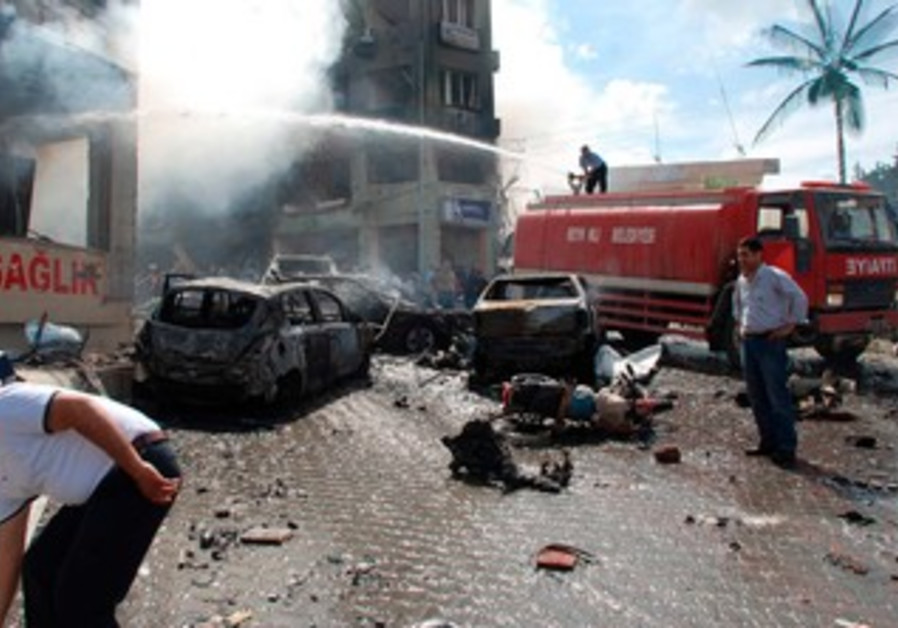 Smoke rises after car bomb blasts in Turkey.