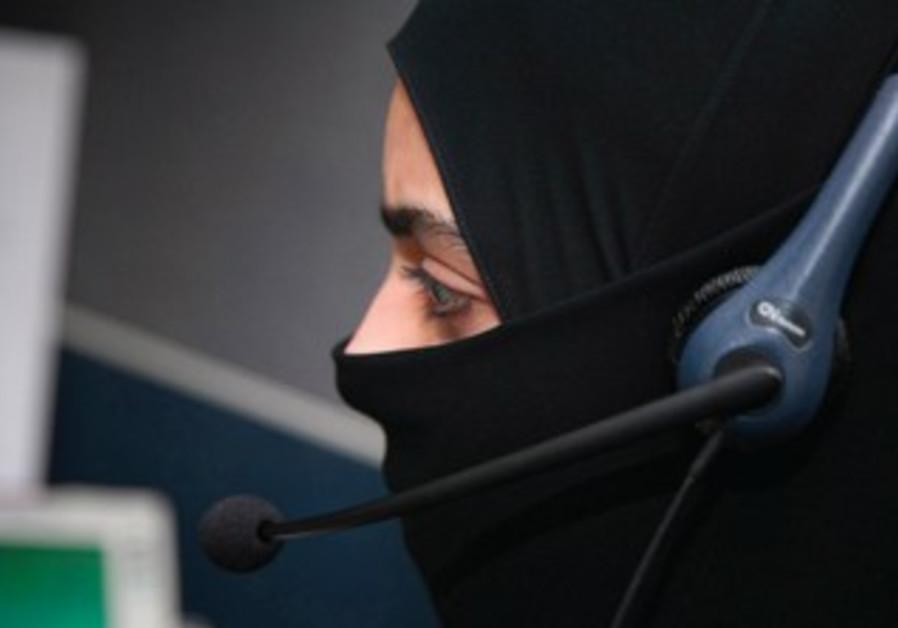 A WOMAN working in a bank in Saudi Arabia
