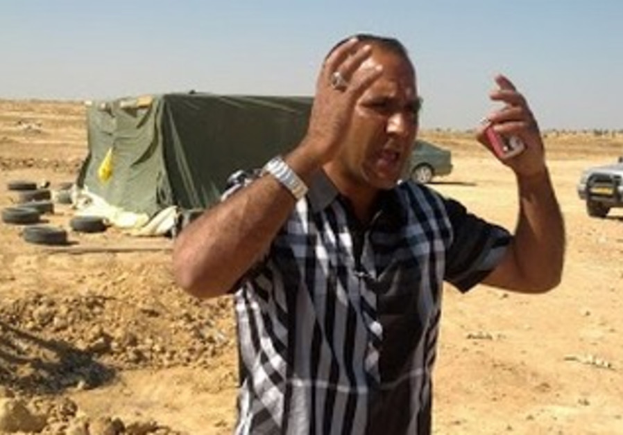 Resident Aziz Al-Toro speaks in al-Arakib last week.