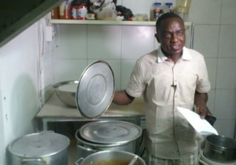 Abdullah Mustafa, a refugee from Darfur, and Neve Shaanan restaurant owner