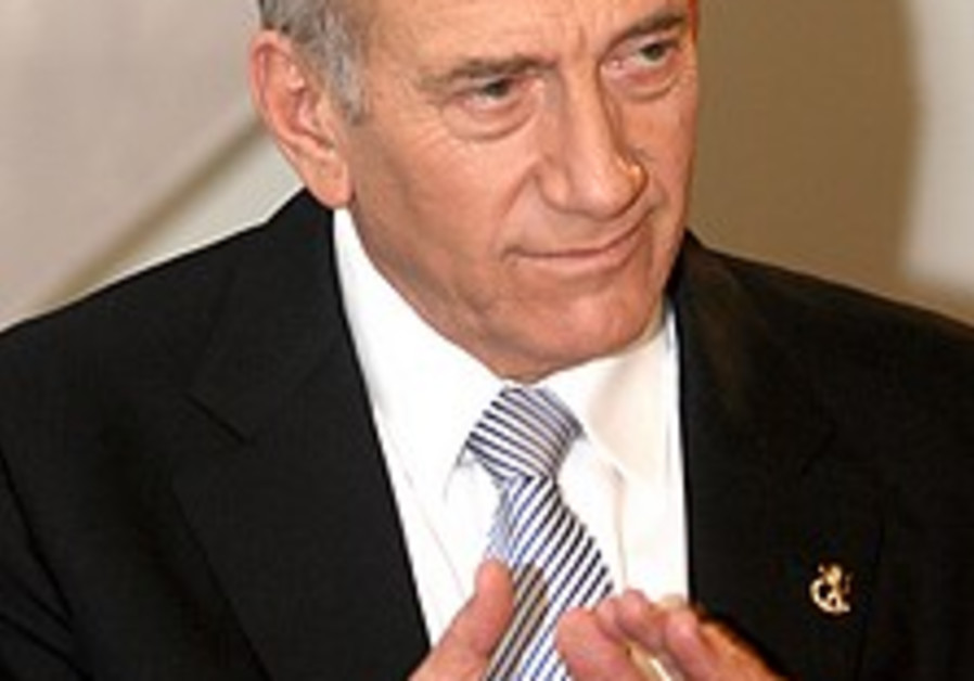 Olmert hits back at Livni and Barak