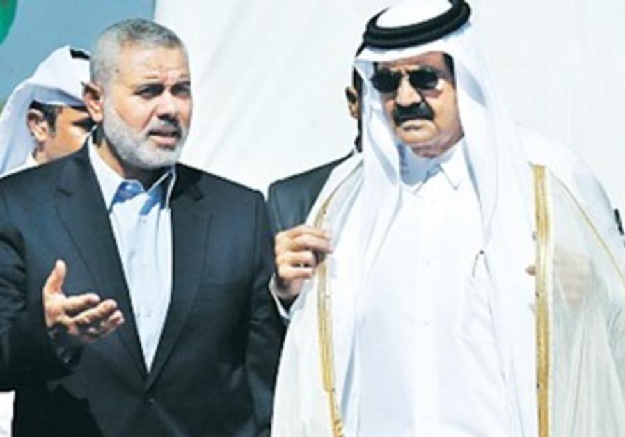 QATAR'S EMIR Hamad bin Khalifa al-Thani in Gaza with Hamas strongman Ismail Haniyeh.
