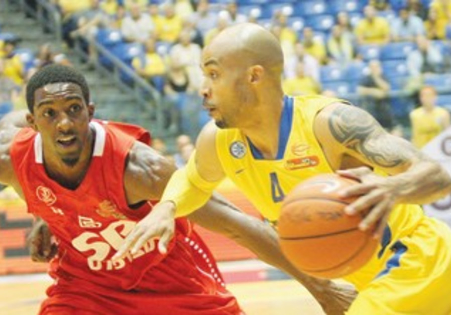 MACCABI TEL AVIV guard David Logan (right) and Demontez Stitt (left) in Game 3 of the BSL playoffs