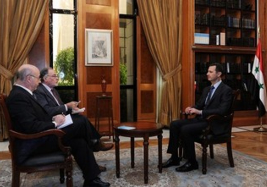 Assad sits for an interview.