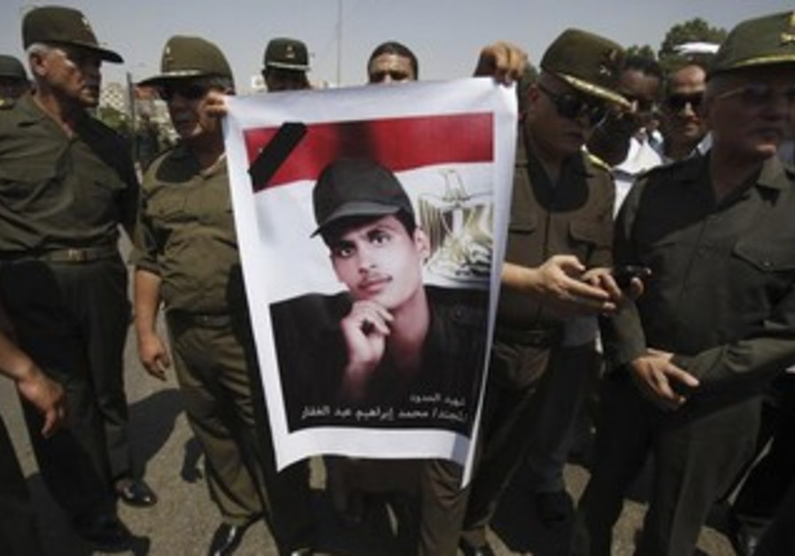 Egpytian soldiers mourn the death of a comrade killed by Gazan insurgents in August 2012.