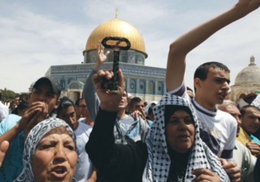 PALESTINIANS PROTEST after prayers at al-Aksa Mosque in Jerusalem's Old City on Friday.