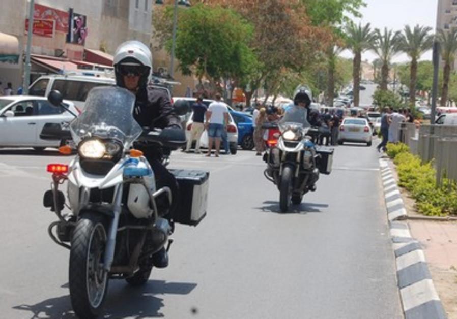 Police near scene of Beersheba bank shooting, May 20, 2013