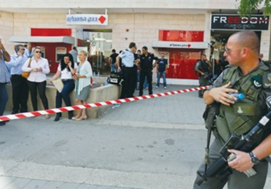 Policeman at Beersheba Bank Hapoalim shooting scene