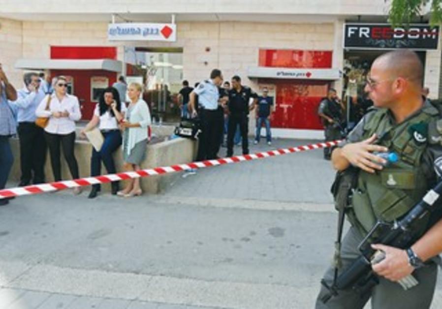 Policeman at Beersheba Bank Hapoalim shooting scene