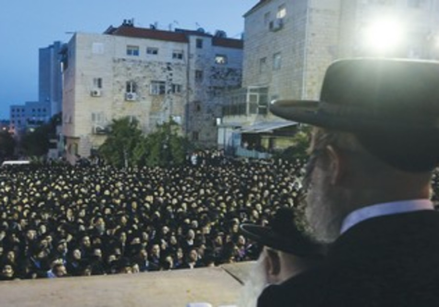 ULTRA-ORTHODOX men gather in the Romema neighborhood in the capital to protest serving in the army