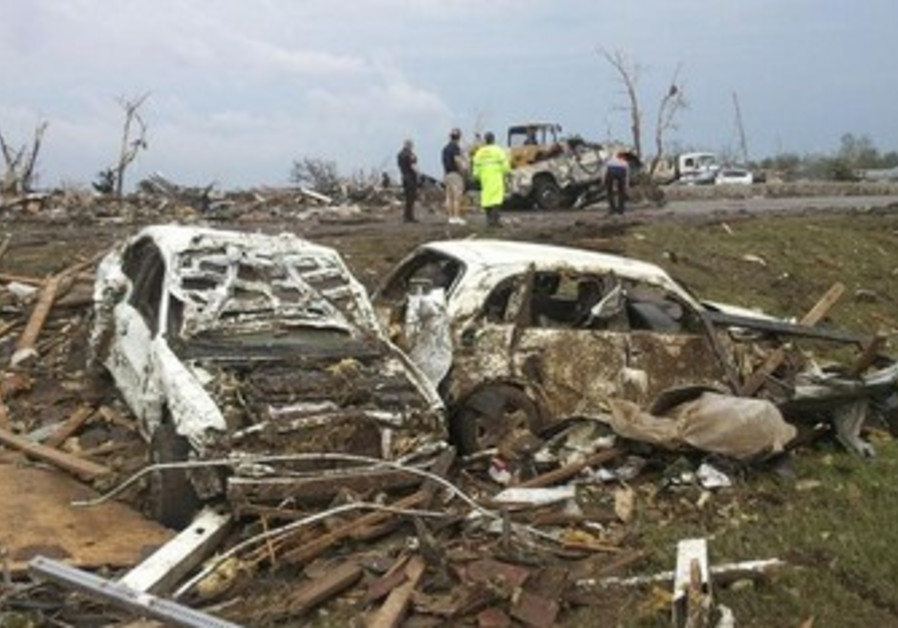 Destroyed cars are seen after a huge tornado struck Moore, Oklahoma May 20, 2013.