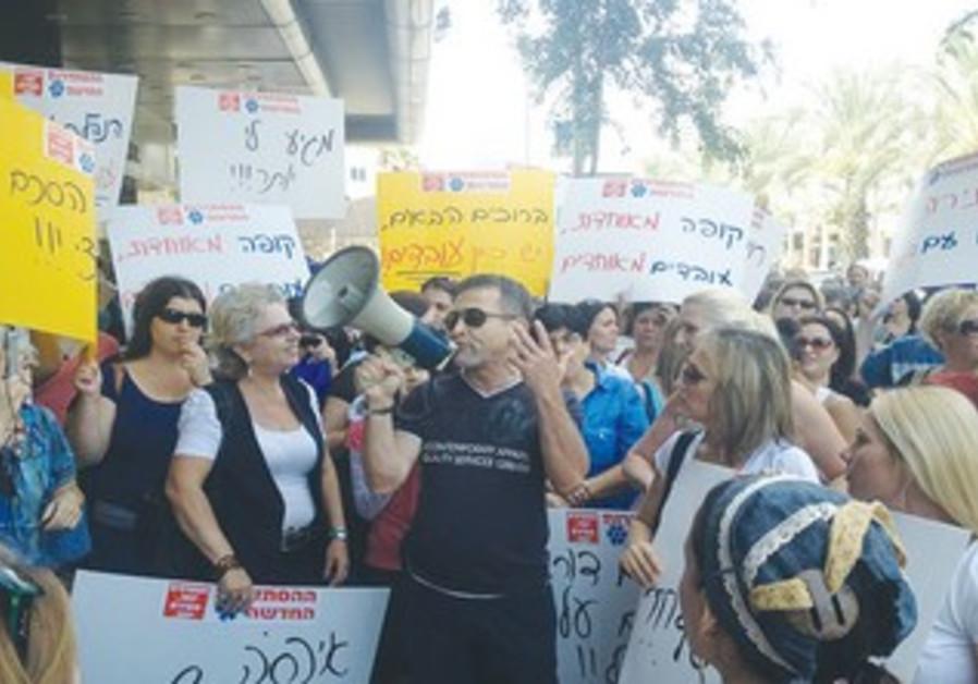 KUPAT HOLIM Meuhedet workers demonstrate in Tel Aviv yesterday