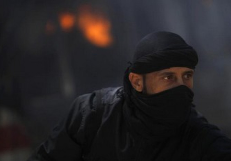 A fighter from the Islamist Syrian rebel group Jabhat al-Nusra