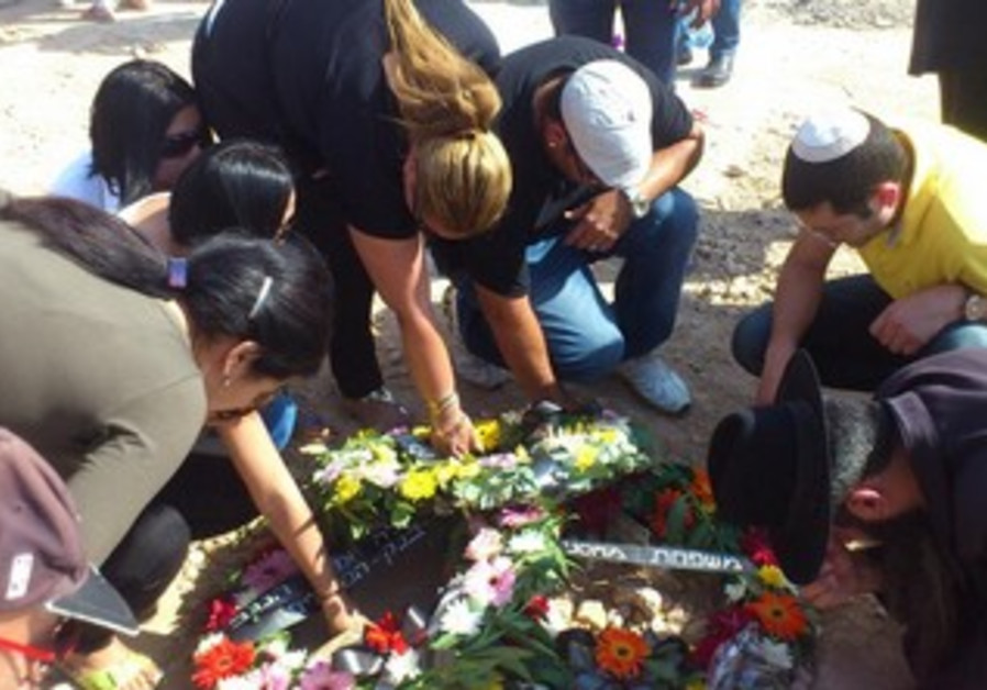 Loved ones touching the grave of Anat Even-Haim, killed in Beersheba shooting on 20th May 2013.