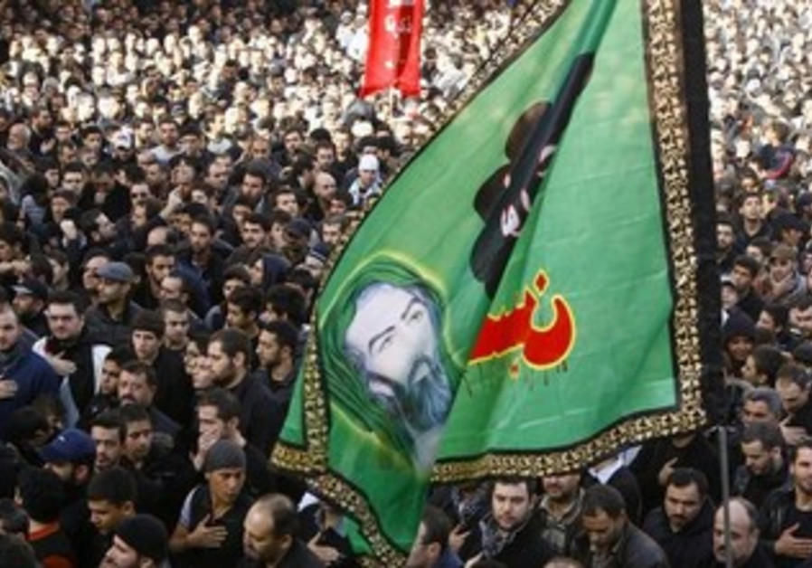Lebanese Hezbollah supporters chant slogans and hold flags