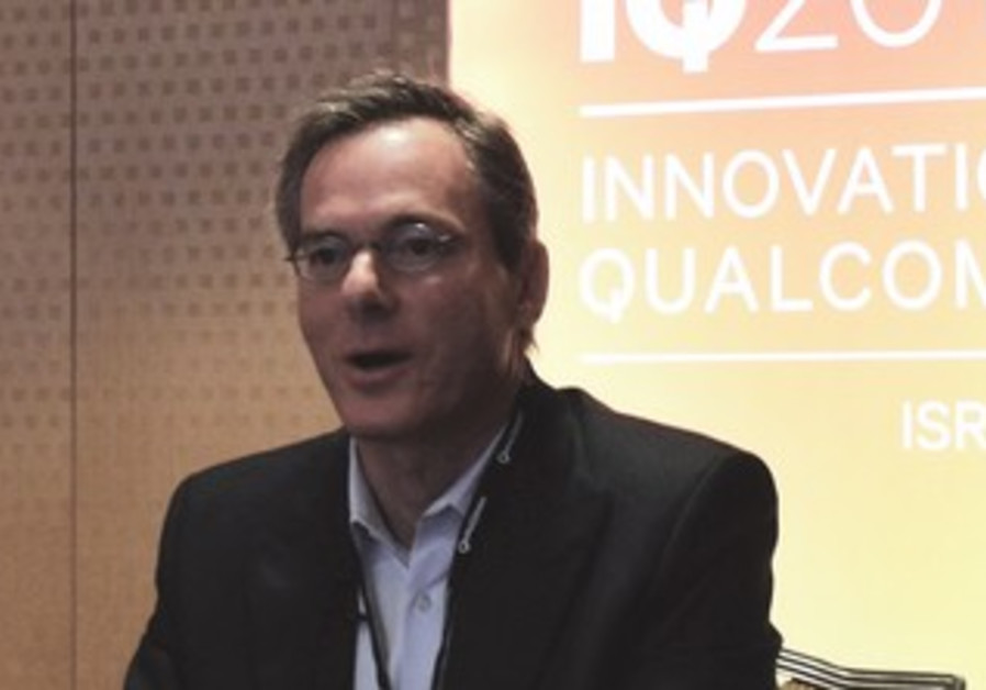 QUALCOMM CEO Paul Jacobs speaks at the IQ2013 convention in Tel Aviv yesterday.