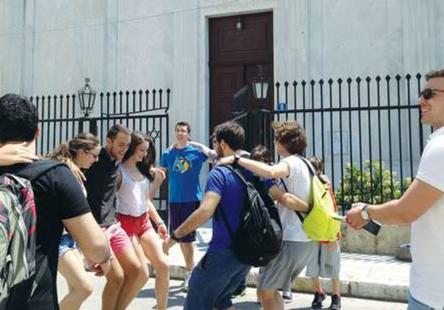 ZIONIST YOUTH leaders dancing in front of the Athens synagogue
