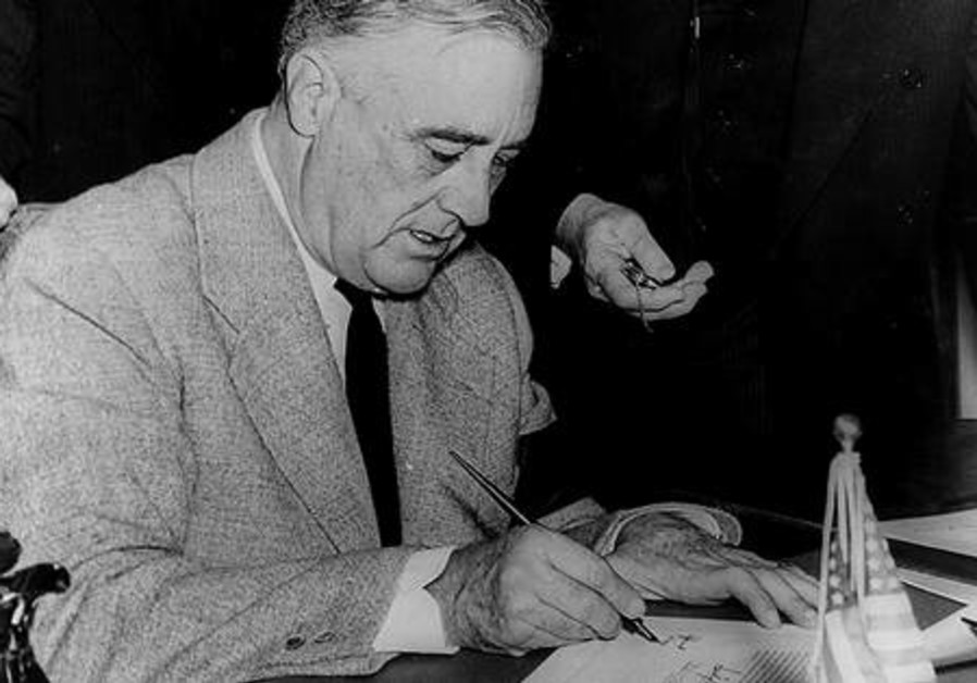 FRANKLIN D. ROOSEVELT signs the declaration of war against Germany on December 11, 1941.