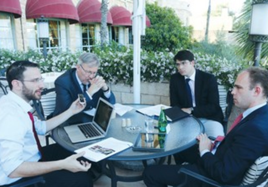 'THE JERUSALEM POST'S Sam Sokol (left) interviews Hungarian PM chief adviser Perenyiat (right)