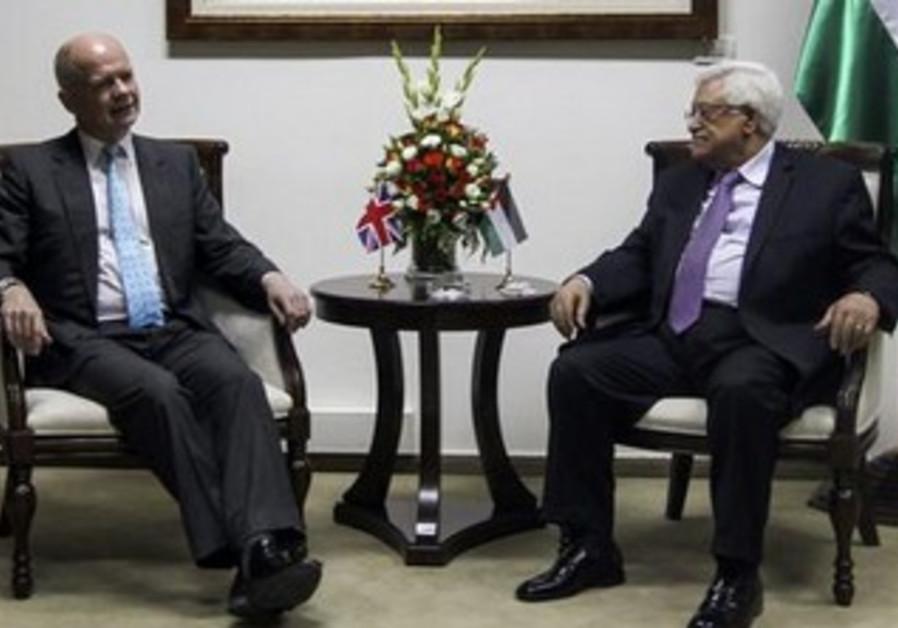 British Foreign Secretary William Hague, PA President Mahmoud Abbas meet in Ramallah, May 23, 2013.