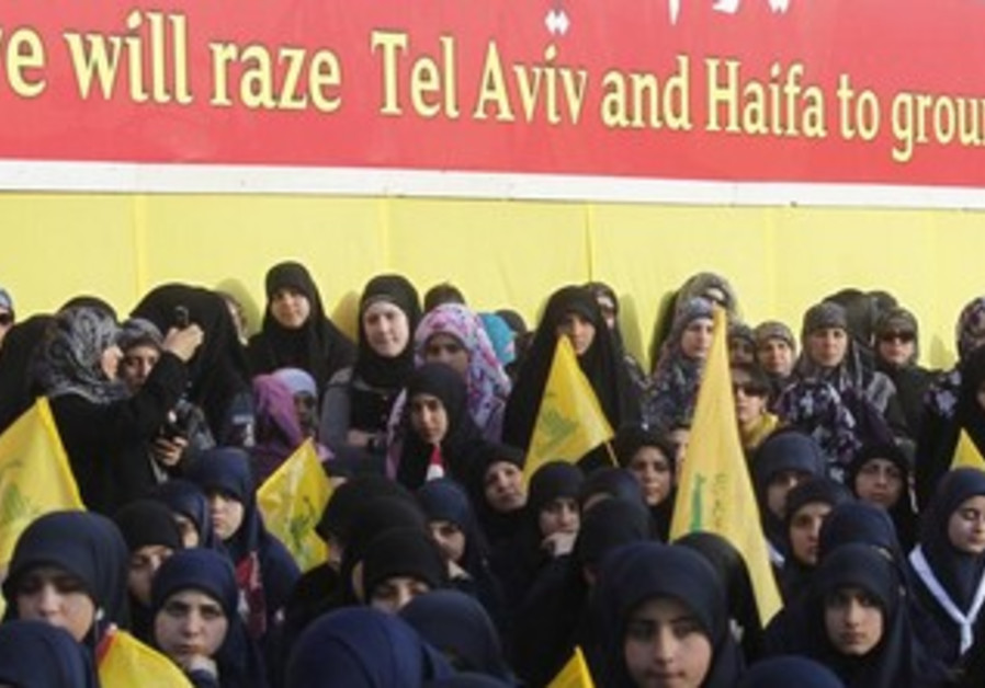 Women are seen watching Nasrallah at an event marking Resistance and Liberation Day, May 25, 2013.