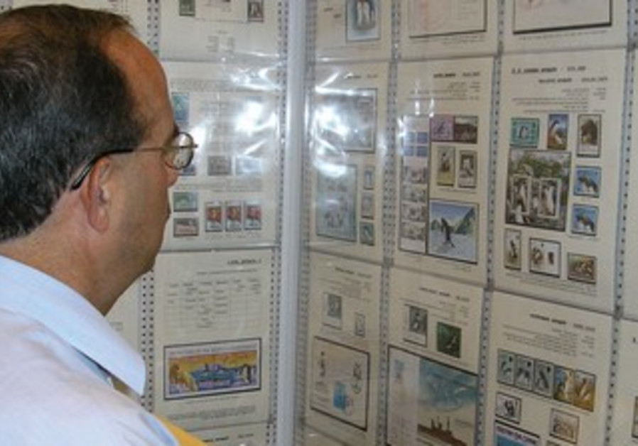 A stamp enthusiast at a Tel Aviv stamp exhibition, May 26, 2013