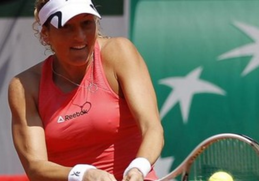 Shahar Peer returns a shot at the Roland Garros tennis tournament, May 27, 2013