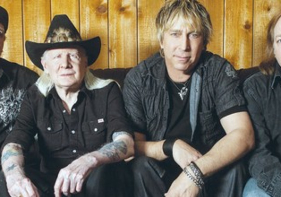 Johnny Winter (2nd from left) seen here with Paul Nelson (2nd from right) and the rest of the Blues.