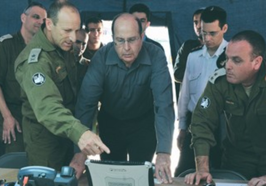 Defense Minister Moshe Yaalon visits IDF Home Front Command's base in Ramle
