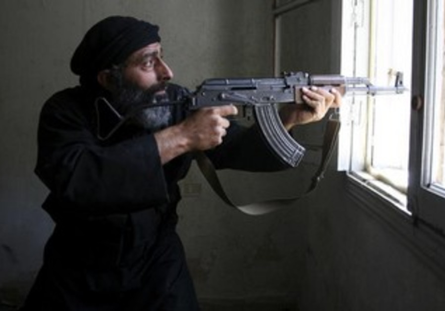 Free Syrian Army fighter  in Aleppo's Salaheddine neighbourhood, April 28, 2013