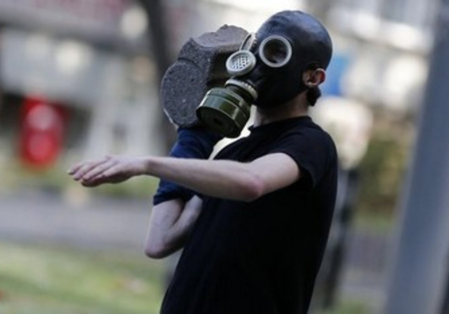 A protester throws a stone at riot police during an anti-government protest in Istanbul,  June 1