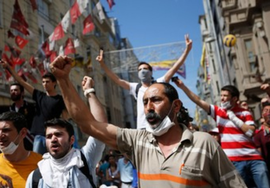 Demonstrators shout slogans during an anti-government protest in Istanbul, June 1