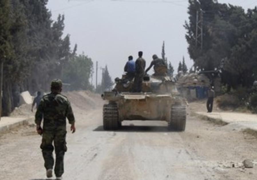 Forces of Syrian President Bashar Assad in Arjoun village near Qusair, May 30, 2013.