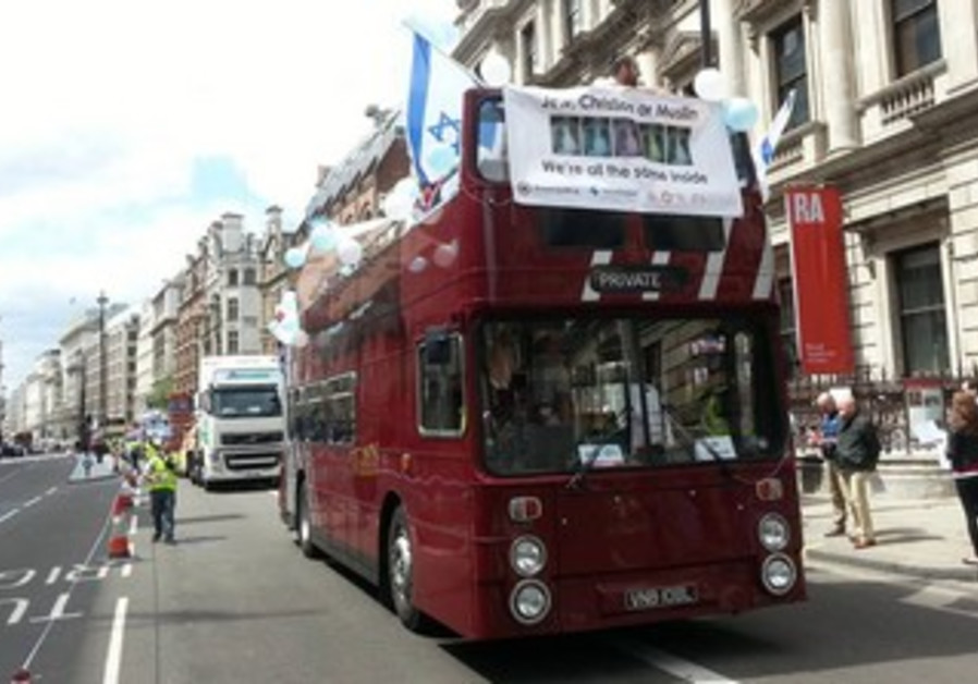 "Banner on London bus reads ""Jews, Christian or Muslim, we're all the same inside."""