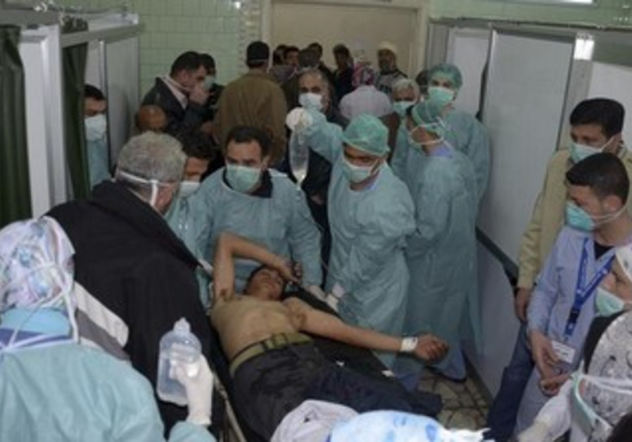 A man, wounded in what the government said was a chemical weapons attack, is treated in Aleppo.