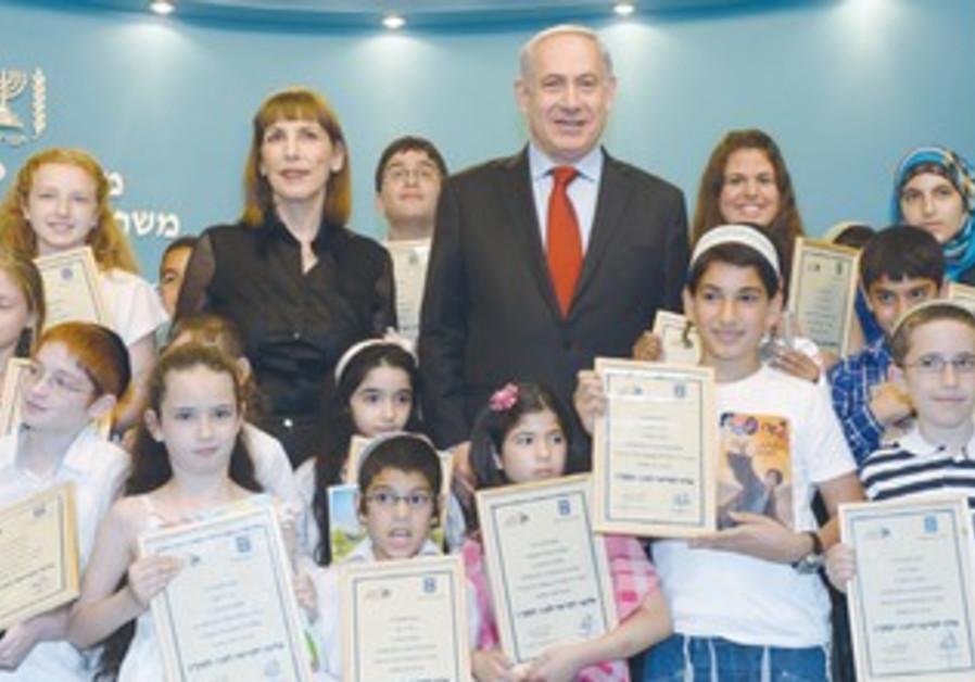 PRIME MINISTER Binyamin Netanyahu and Culture Minister Limor Livnat award reading certificates