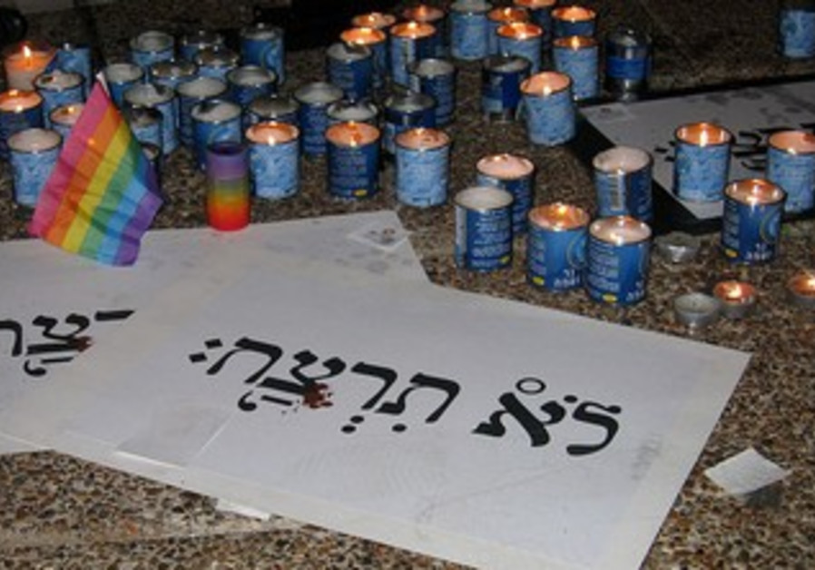 Memorial candles lit after 2009 shooting at the Bar Noar LGBT youth center.