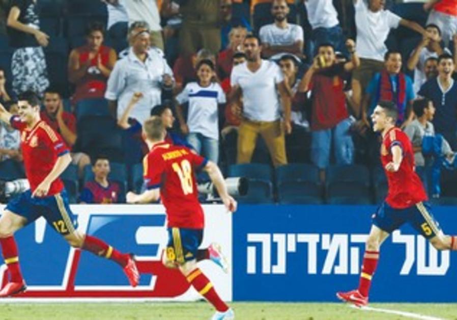ALVARO MORATA (left) celebrates his goal with Spanish teammates