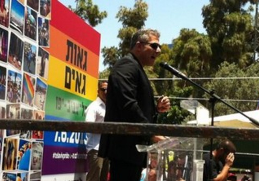 Finance Minister Yair Lapid addressing the crowd at the Gay Pride Parade kick off at Gan Meir.