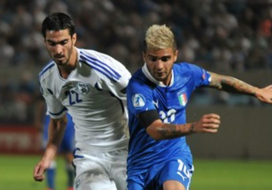 Israel's Ofir Kriaf and Italy's Lorenzo Insigne