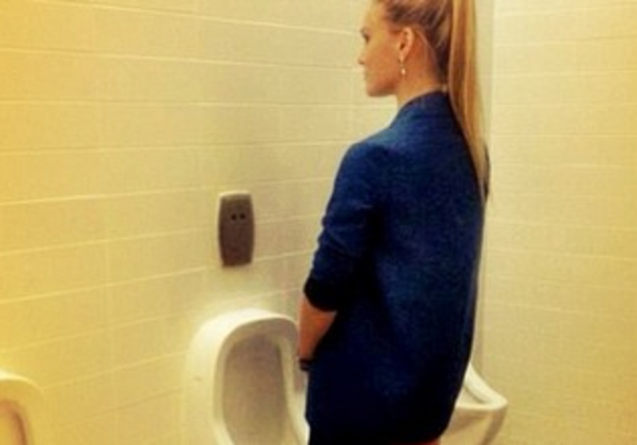 Israeli model Bar Refaeli posing in front of a urinal.