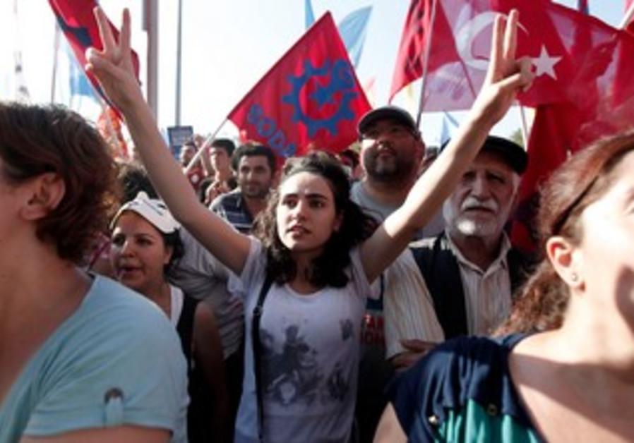 Anti-Erdogan protesters crowd Ankara's Taksim square.