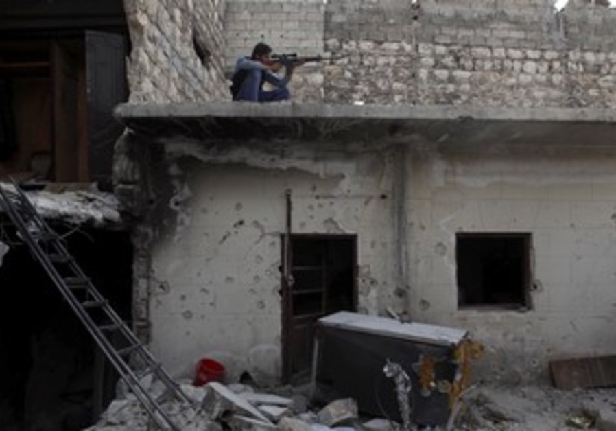 A Syrian rebel fighter takes aim from a rooftop during the fighting.