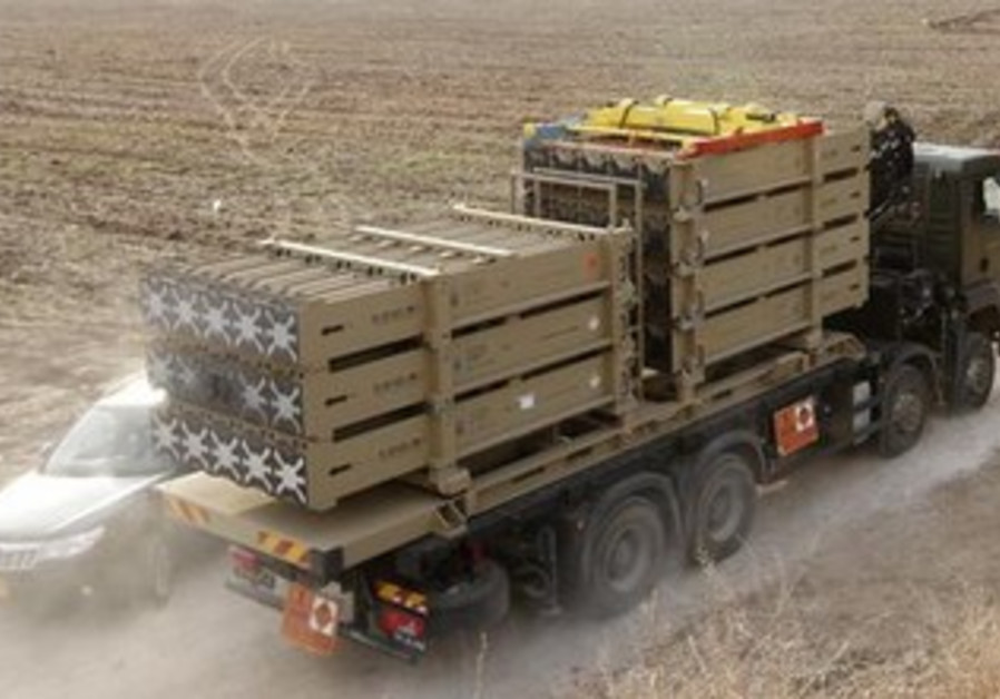 A truck transfer Iron Dome missiles in Israel.