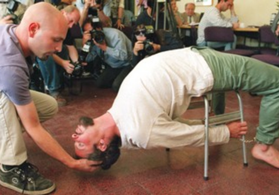 """HUMAN RIGHTS activists demonstrate an alleged Shin bet interrogation technique known as the """"Banana'"""