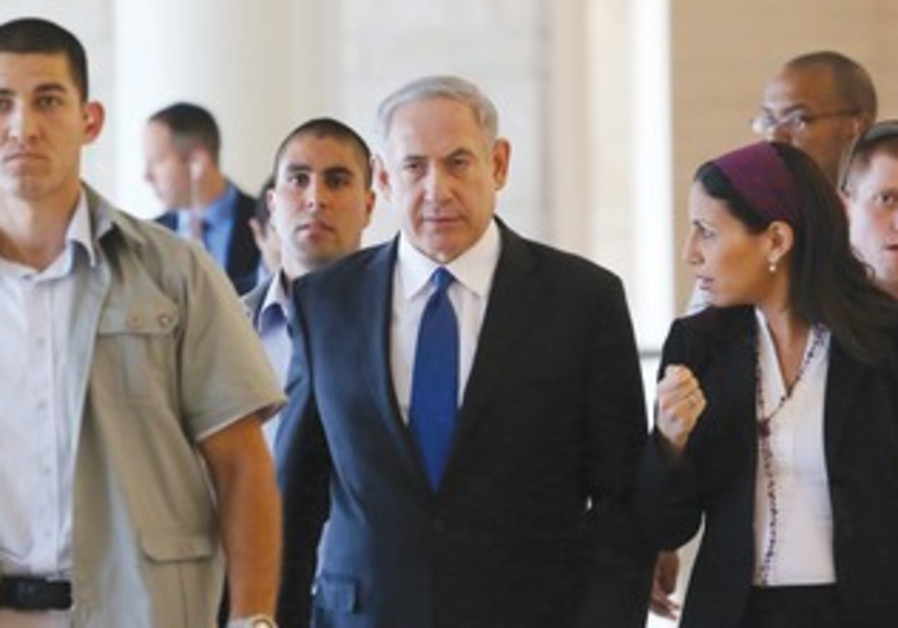 BINYAMIN NETANYAHU strides the corridors of the Knesset this week.