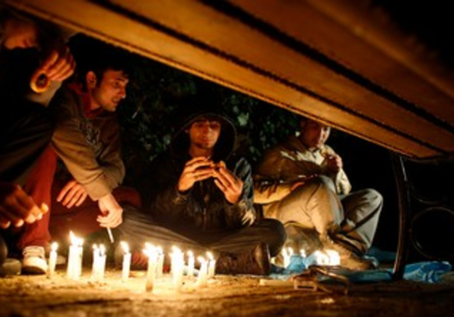 Anti-government protesters light candles in Kugulu Park in Ankara June 13, 2013.