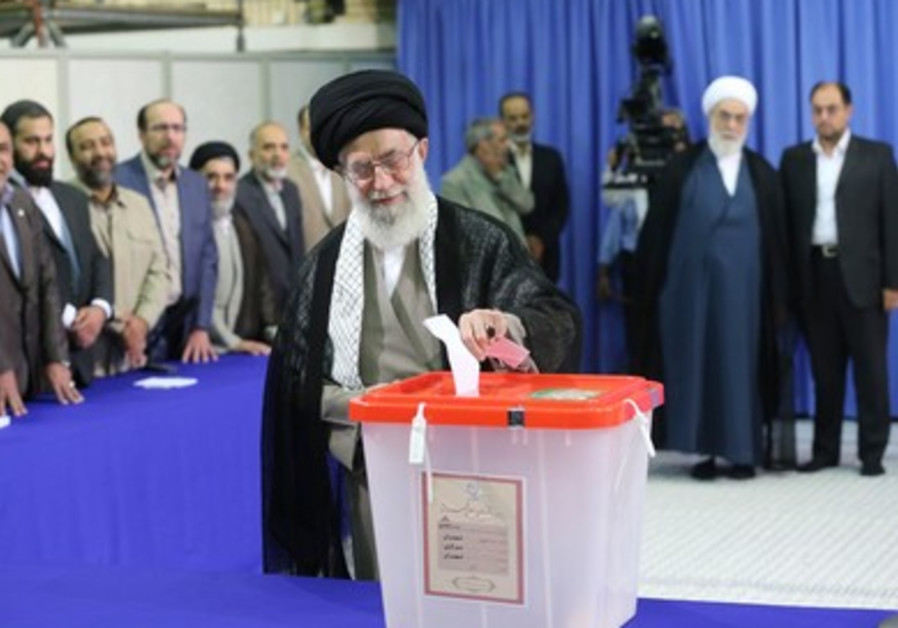 Iranian Supreme Leader Ayatollah Ali Khamenei casts ballot during Iranian presidential elections