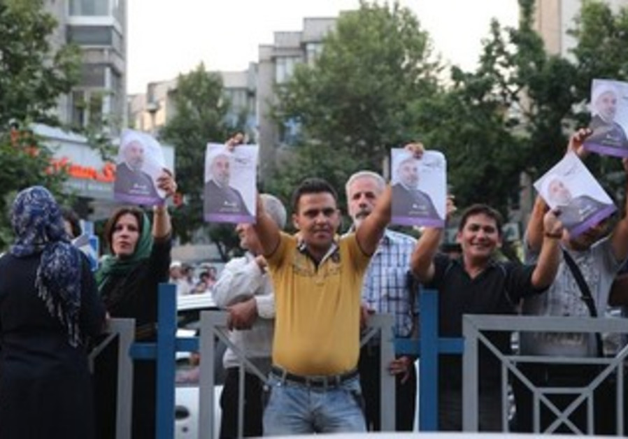 Supporters of moderate cleric Hassan Rohani celebrate his victory in Iran's presidential election